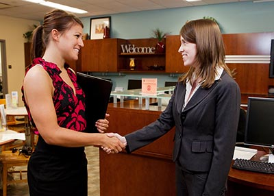student shaking hands in a mock interview